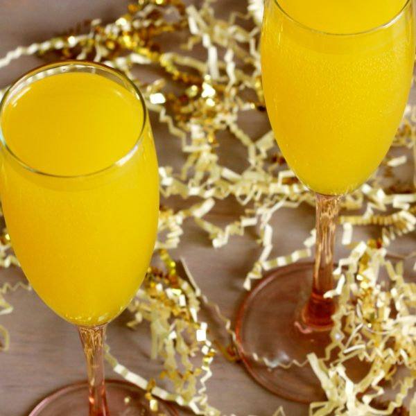 The classic Mimosa cocktail is more than just champagne and orange juice, even though that's how some bartenders pour it. It's a wonderful way to use up leftover champagne, and it's so easy to pour when you're entertaining.