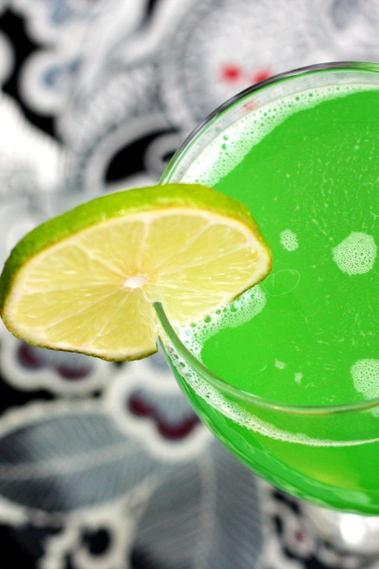 Overhead view of Green Demon drink with lime wheel garnish