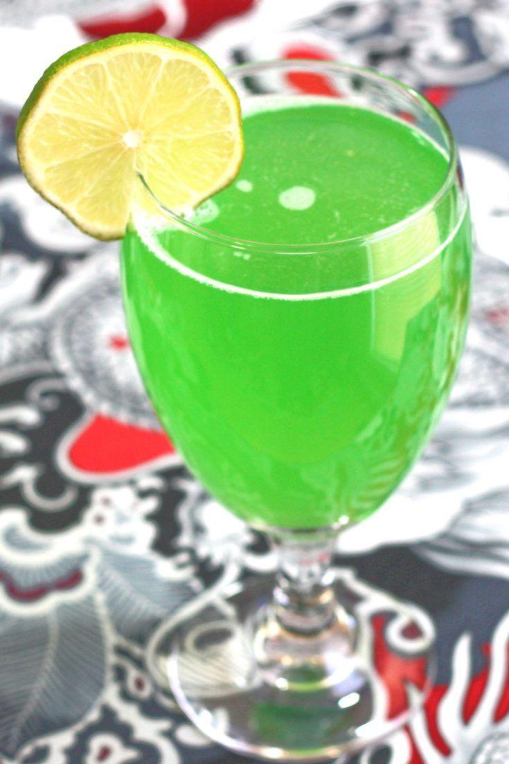 Green Demon drink with lime wheel garnish