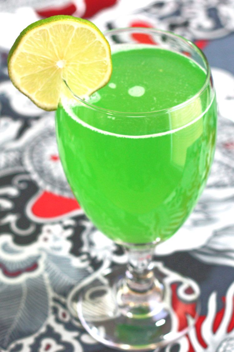 Green Demon drink with lime wheel garnish