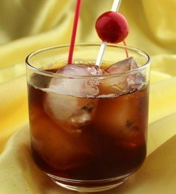 Mandeville drink recipe - Rum, Anisette, Lemon Juice, Grenadine, Cola
