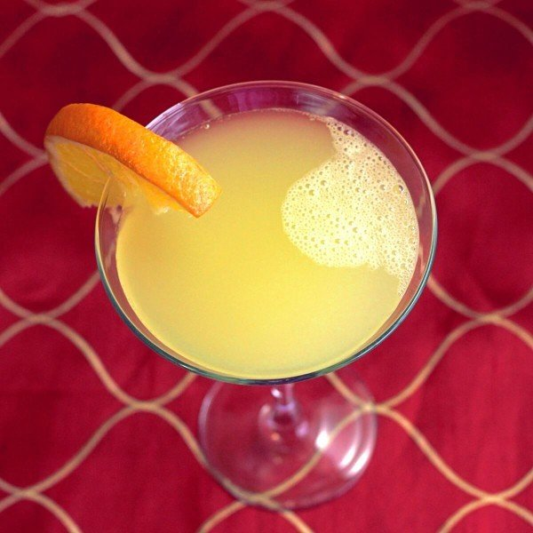 Overhead view of Cowboy Roy cocktail with orange slice