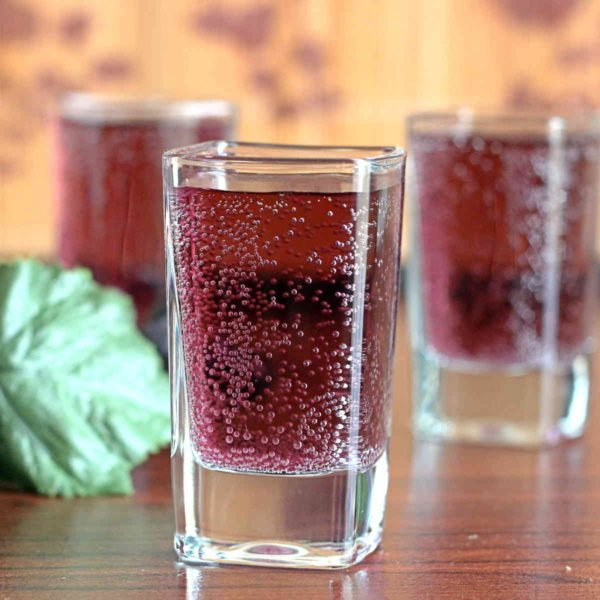 The Pamoyo cocktail recipe is great for parties, because you can mix up a whole pitcher, chill it, and pour as you go. This drink tastes like grape juice and citrus, with hints of herbs. You can make it a shot or a longer drink.