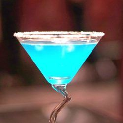 The Blue Goose cocktail is gorgeous, and it tastes like lime and tropical fruit with hints of something flowery. It's a unique flavor that will surprise you. #mixthatdrink #drinkrecipes #hpnotiq #cocktails
