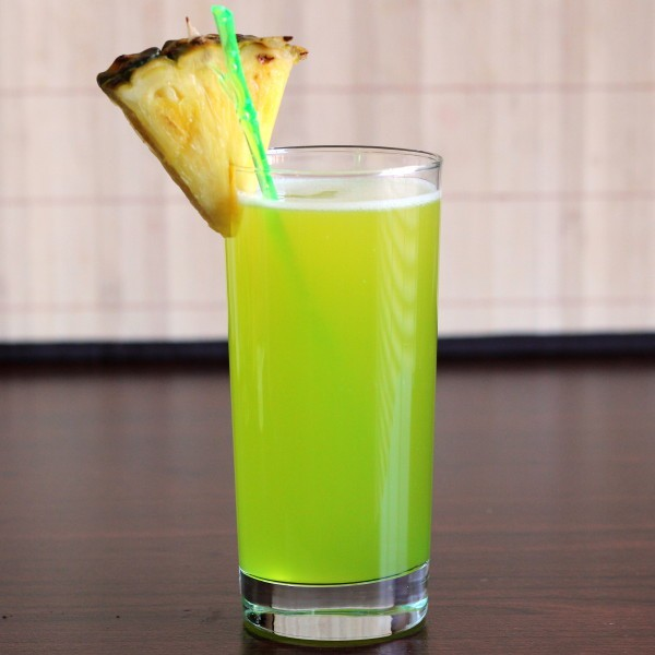 Monkey In a Tree drink with pineapple wedge