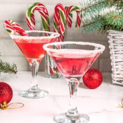 Two Candy Cane Martini drinks with candy cane garnish