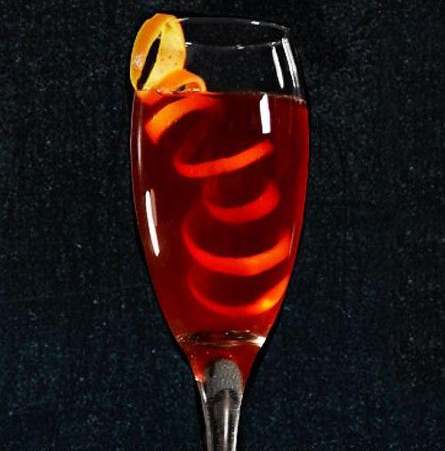 Cranberry Kiss drink with elaborate orange twist