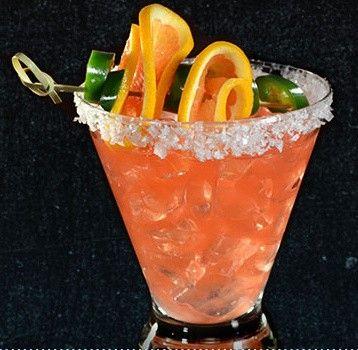 Jalepeno's Revenge Margarita with orange and jalapeno garnish