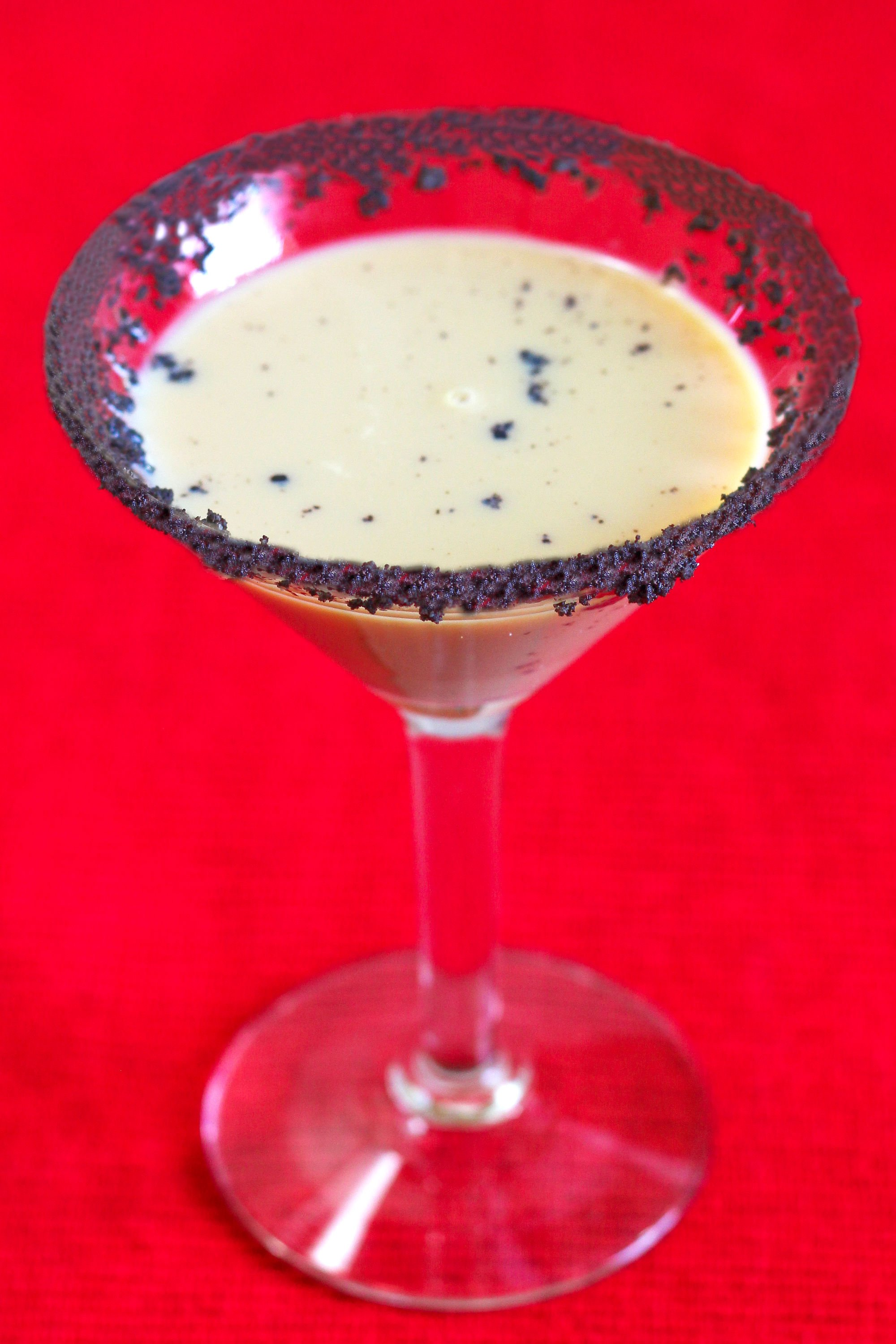 The Reindeer Tracks Martini is a delicious blend of chocolate vodka, Frangelico and creme de cacao, garnished with a chocolate cookie rim. Chocolate and a hint of hazelnut are so easy to love together.
