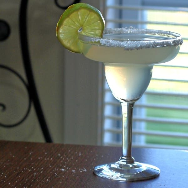 If you're wasting away in Margaritaville, the Jimmy Buffett Margaritaville Perfect Margarita is just the drink you need. This margarita recipe blends gold and white tequilas with triple sec, curacao and Rose's lime juice. #perfectmargarita #margaritavillemargarita #margaritarecipes #tequilarecipes #margaritadrinks