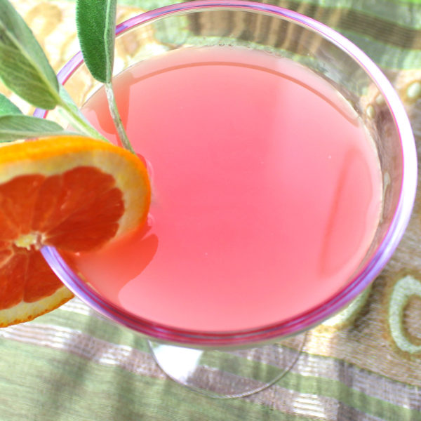 Blood Orange Margarita recipe with silver tequila, blood orange juice, lime, Cointreau and sage.