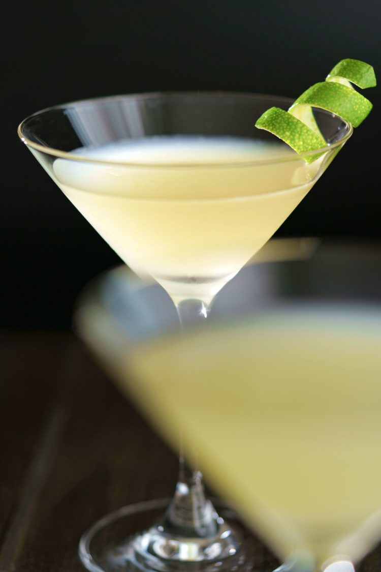 Close up view of Elderflower Martini with lime twist