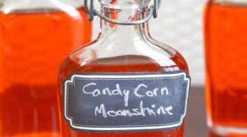 Candy Corn Moonshine infusion in glass flasks