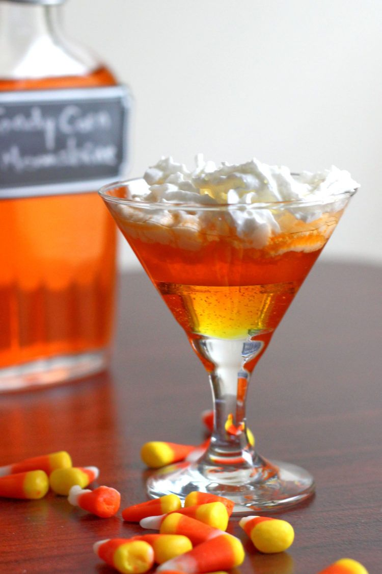 This Candy Corn Moonshine infusion is loads of fun, especially for tailgating and Halloween parties. This easy recipe also works with vodka or rum if you prefer. #candycornmoonshine #candyvodka #candycorn #halloweendrinks #tailgatingdrinks #candycornvodka