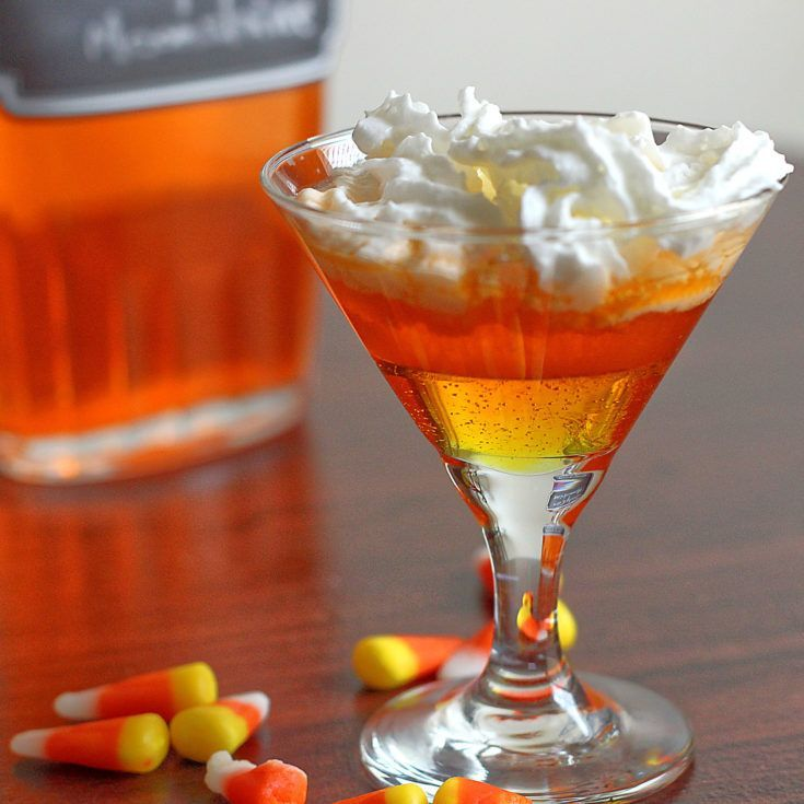 Candy Corn Moonshine in a glass with whipped cream