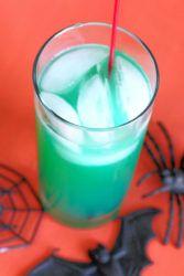 Green Spooky Juice drink against orange backdrop