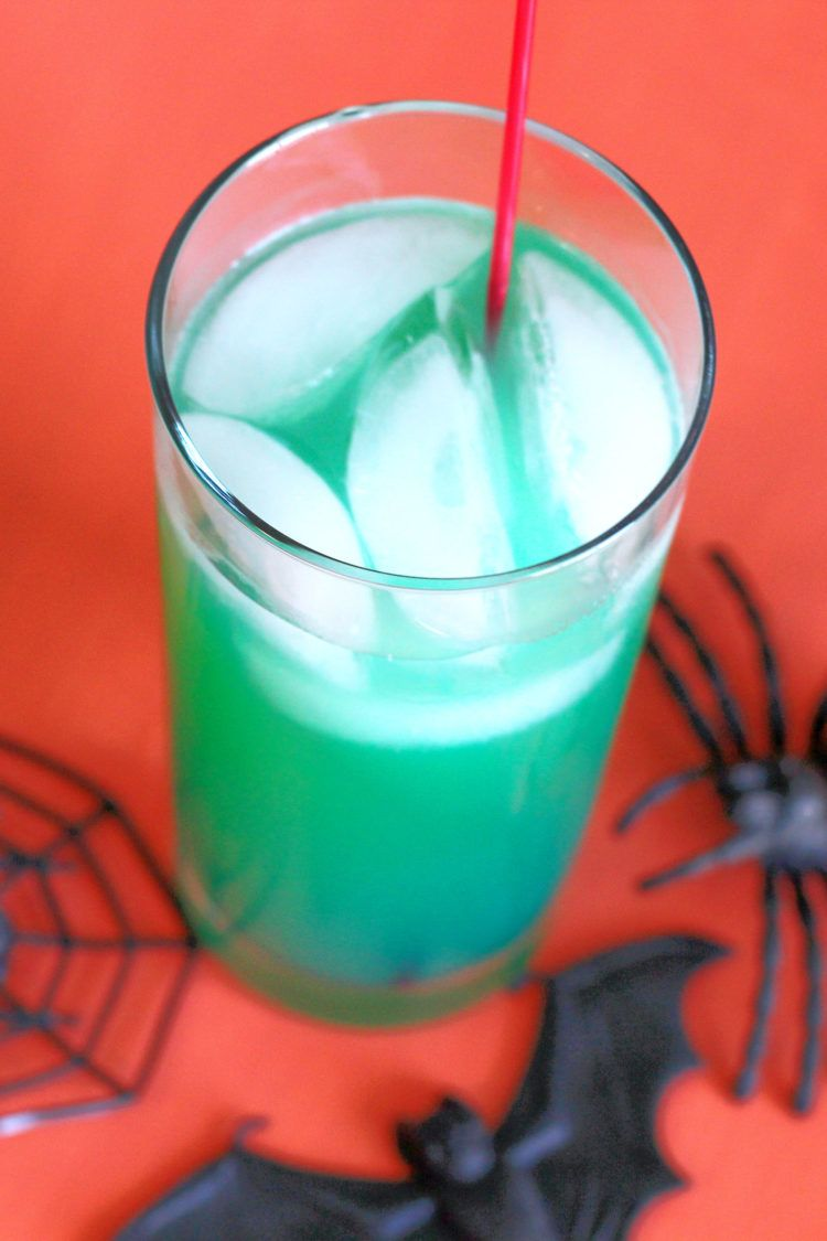 Green Spooky Juice drink against orange backdrop