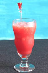 Red mocktail in a hurricane glass