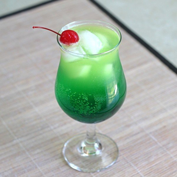 The Zolezzi Cocktail recipe with Midori, blue curacao, vanilla vodka, rum, pineapple juice and Sprite.