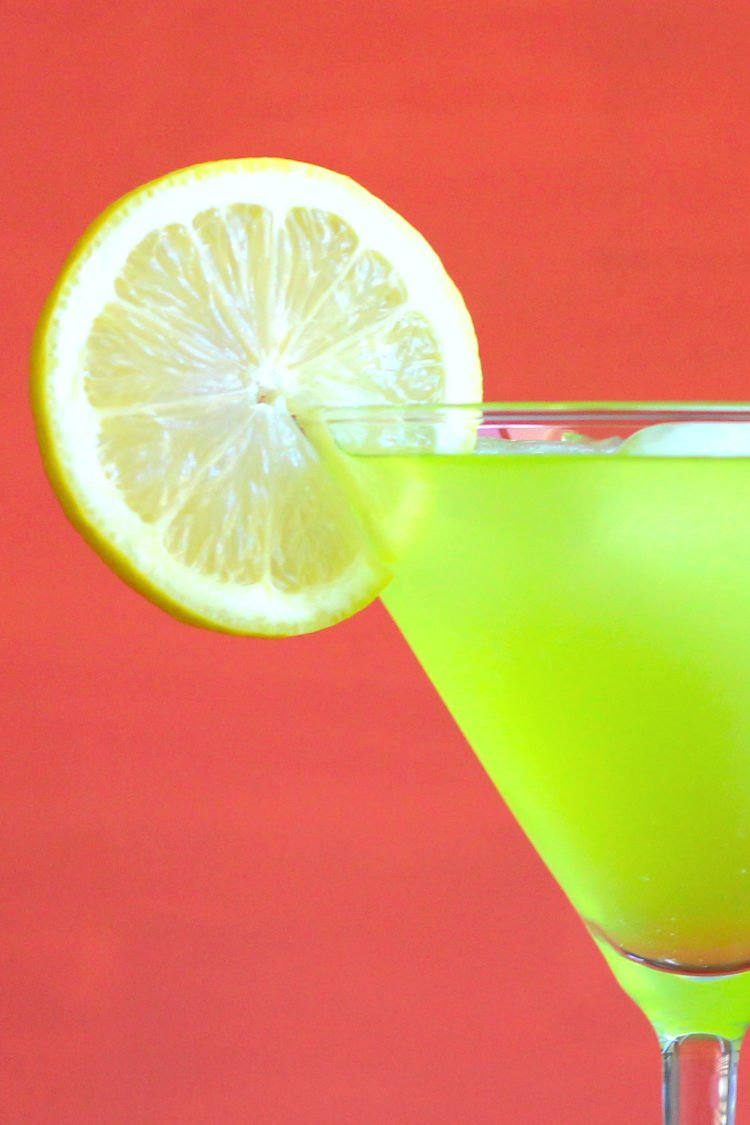 A green Super Bowl drink with lime garnish