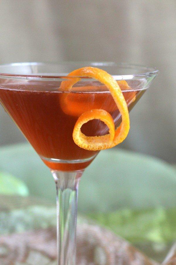 East India Cocktail recipe with cognac, dark rum, triple sec, pineapple juice and Angostura bitters.
