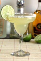 Honey Vanilla Margarita in front of liquor bottles