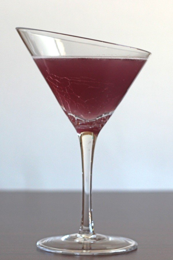 Purple Turtle drink recipe with coconut rum, triple sec, cranberry juice and blue curacao.