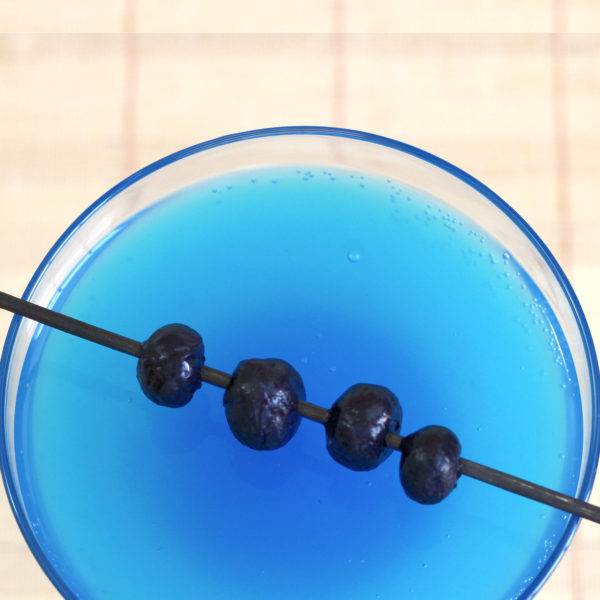 The Avartini Cocktail features Stolichnaya Blueberi Vodka, along with some blue curacao and Sprite. It's mostly blueberry with a touch of orange, and some refreshing bubbles. It's also absolutely gorgeous.