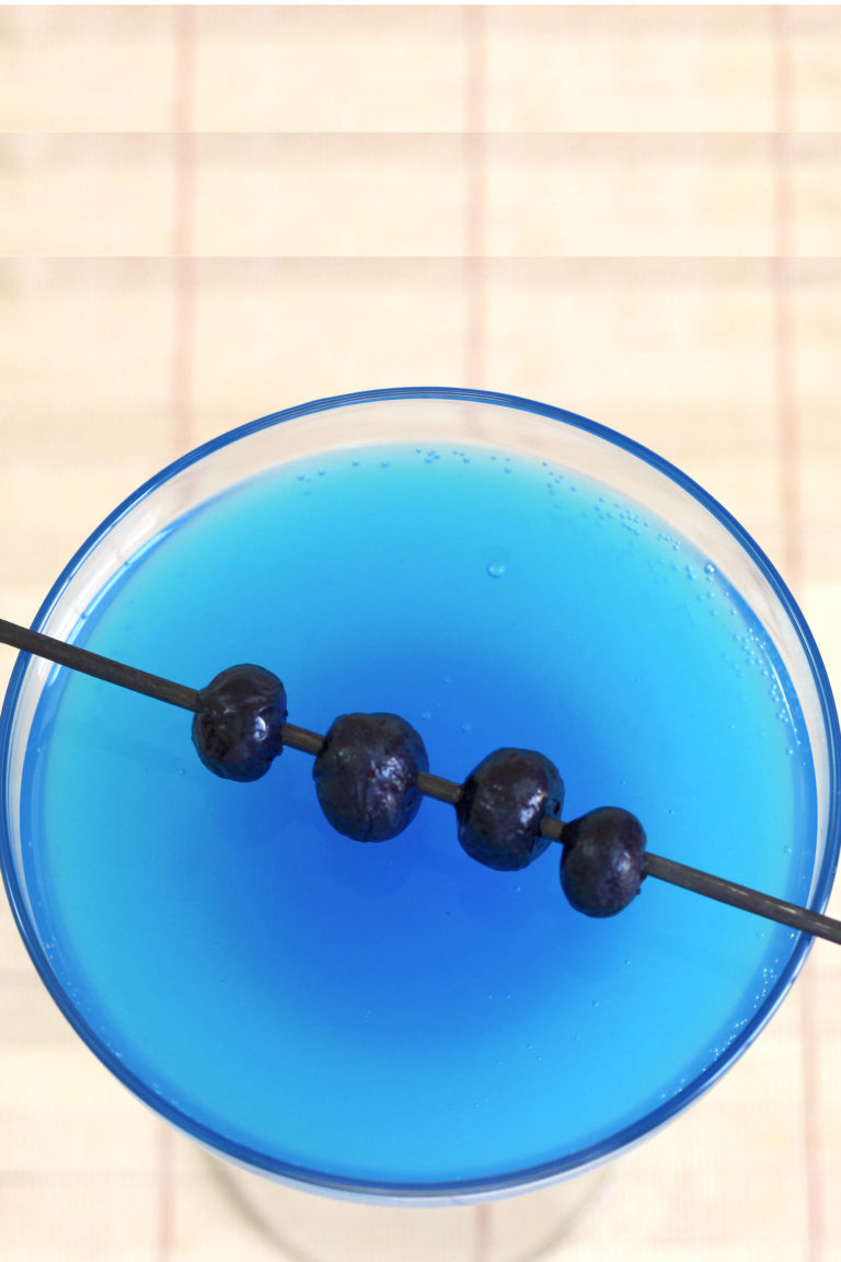 Overhead view of Avartini Cocktail with blueberries