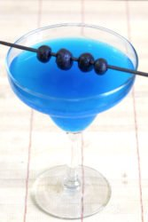 Bright blue Avartini Cocktail with blueberries