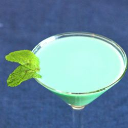 Creamy green Grasshopper cocktail with mint sprig