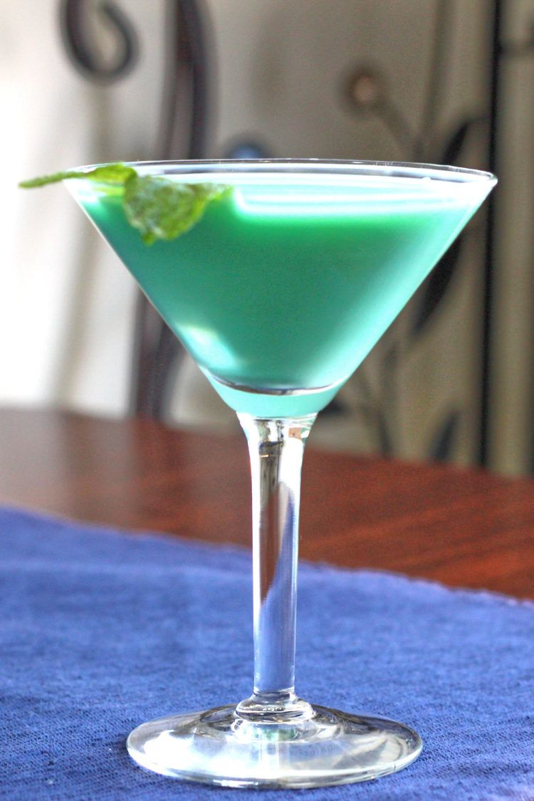 Grasshopper drink with mint sprig on table