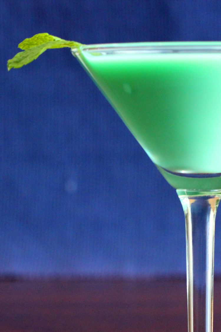 Closeup of creamy green Grasshopper drink with mint sprig