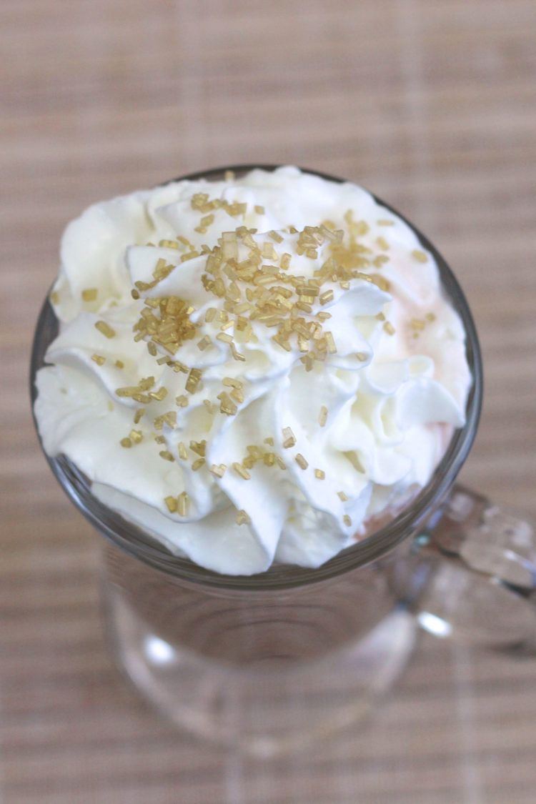 Overhead shot of Irish Coffee drink with whipped cream and sprinkles