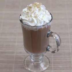 Irish Coffee drink with whipped cream and sprinkle