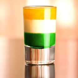 Irish Flag shot drink with layers of green, white and orange