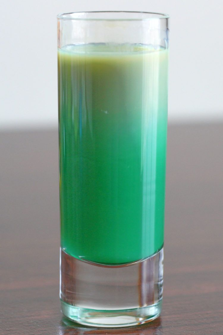 Green Irish Flag shot drink stirred to obliterate layers