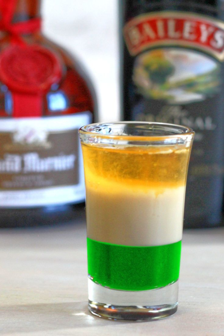 The Irish Flag shot drink is a layered cocktail with green creme de menthe, Baileys Irish Cream and Grand Marnier to form  the colors of the Irish flag. The flavor is a surprisingly tasty blend of vanilla, mint and orange.