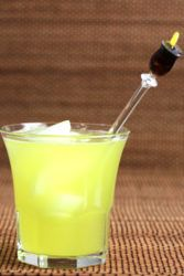 Bright yellow Arcadia Cocktail in rocks glass with ice
