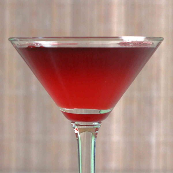 The Crimson Cocktail is unusually sweet for a gin-based cocktail. This recipe features gin and either lemon or lime juice, but adds to those a combined ounce of grenadine and port.