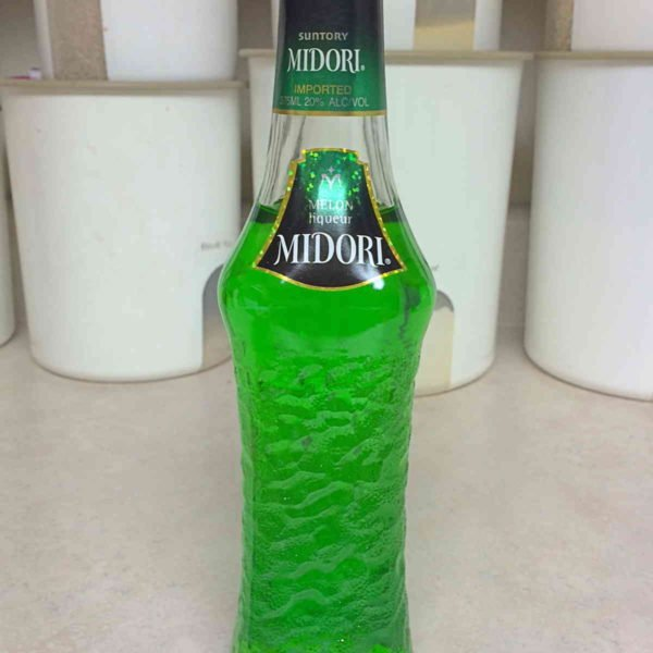 Detailed tasting notes and review of Midori melon liqueur. It's a beautiful green liqueur with the sweet flavor of honeydew, and it works well in many cocktails. Click through to learn more!