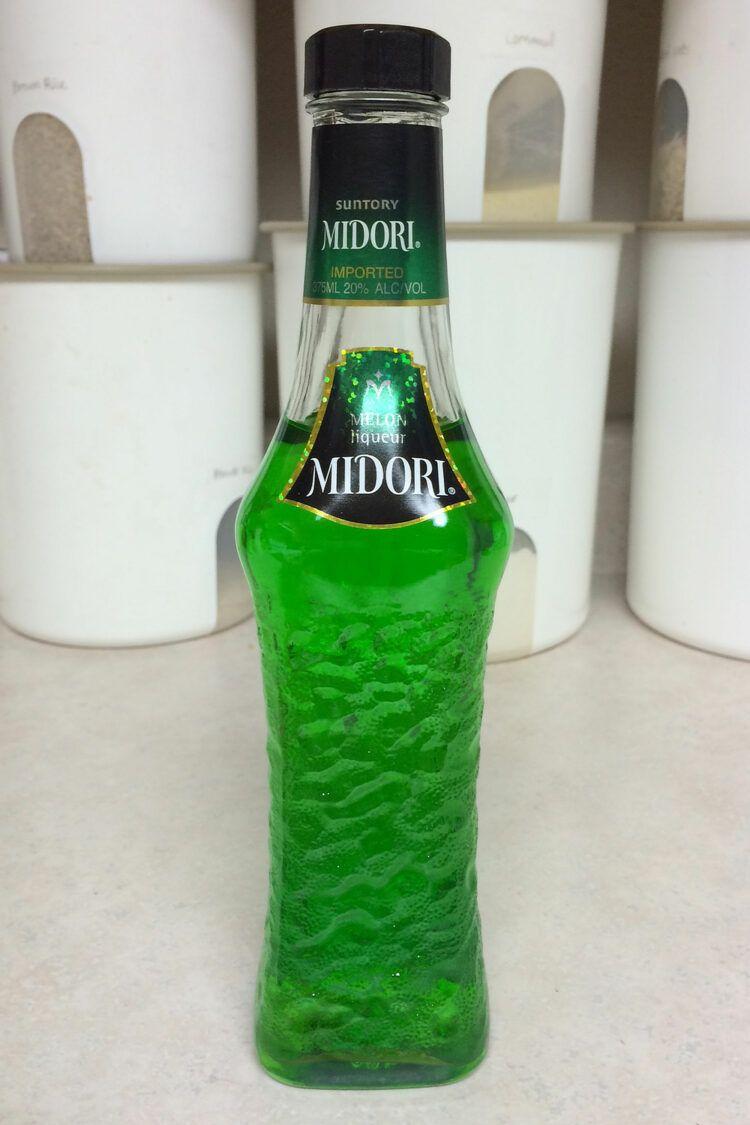 Bottle of Midori on countertop