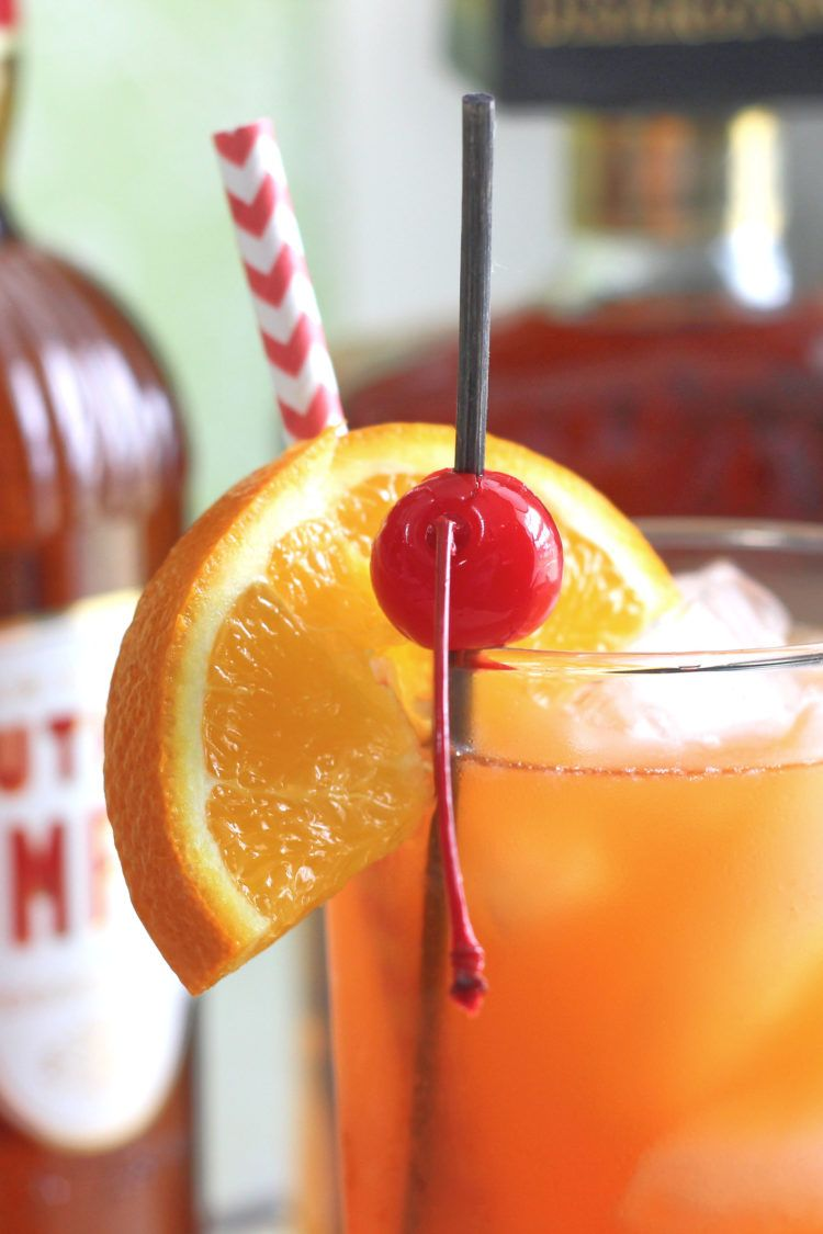 Closeup of Alabama Slammer orange and cherry garnish