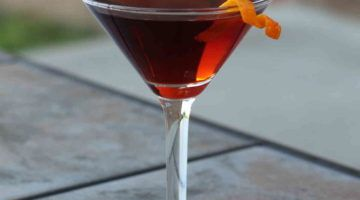 The Boulevardier drink recipe is a lot like the Negroni, except for one important detail. It uses whiskey instead of gin, and the flavor difference is surprising, even with the other ingredients being the same.