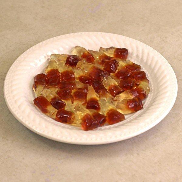 Rum 'n' Coke Gummies on a white plate
