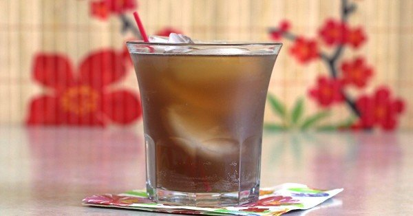 Tennessee Tea drink served on cocktail napkin with red straw