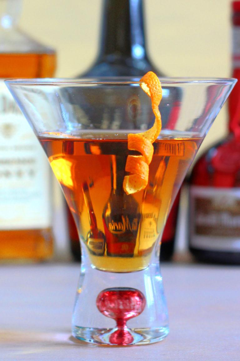 Closeup of Jack's Grand Ball cocktail in decorative martini glass