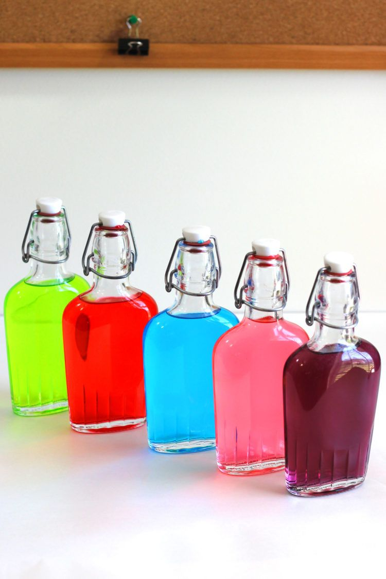 Finished Jolly Rancher Vodka infusions in flasks