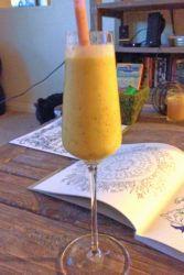 Piñarita Cocktail on table next to open book