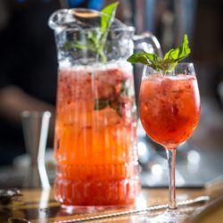Strawberry Smash drink recipe with vodka, strawberry, basil and lemon juice.